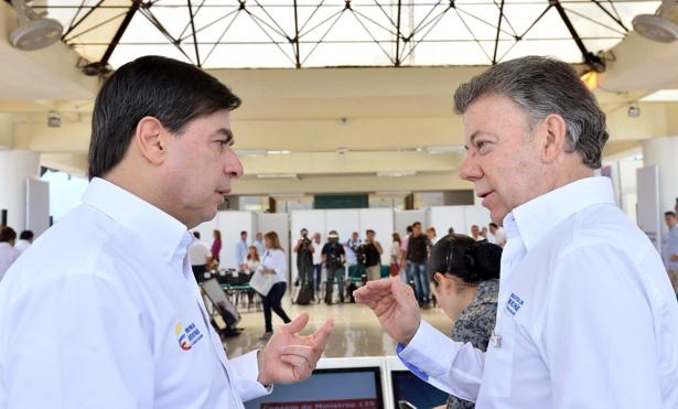 Juan Fernando Cristo y Juan Manuel Santos