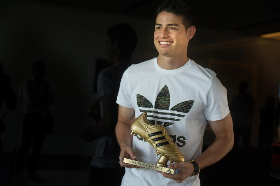 MADRID, SPAIN - AUGUST 07:  Footballer James Rodriguez receives his adidas Golden Boot Trophy at Real Madrid's Valdebebas in recognition of scoring the most goals during the 2014 FIFA World Cup on August 7, 2014 in Madrid, Spain.  (Photo by Denis Doyle/Getty Images for adidas)