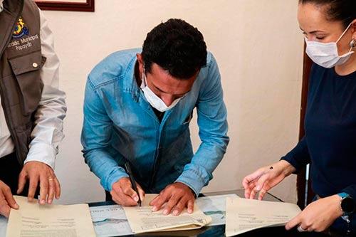 Comunidades firman acuerdo